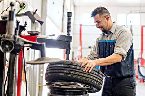 Nissan Technician changing tire Ajax Nissan