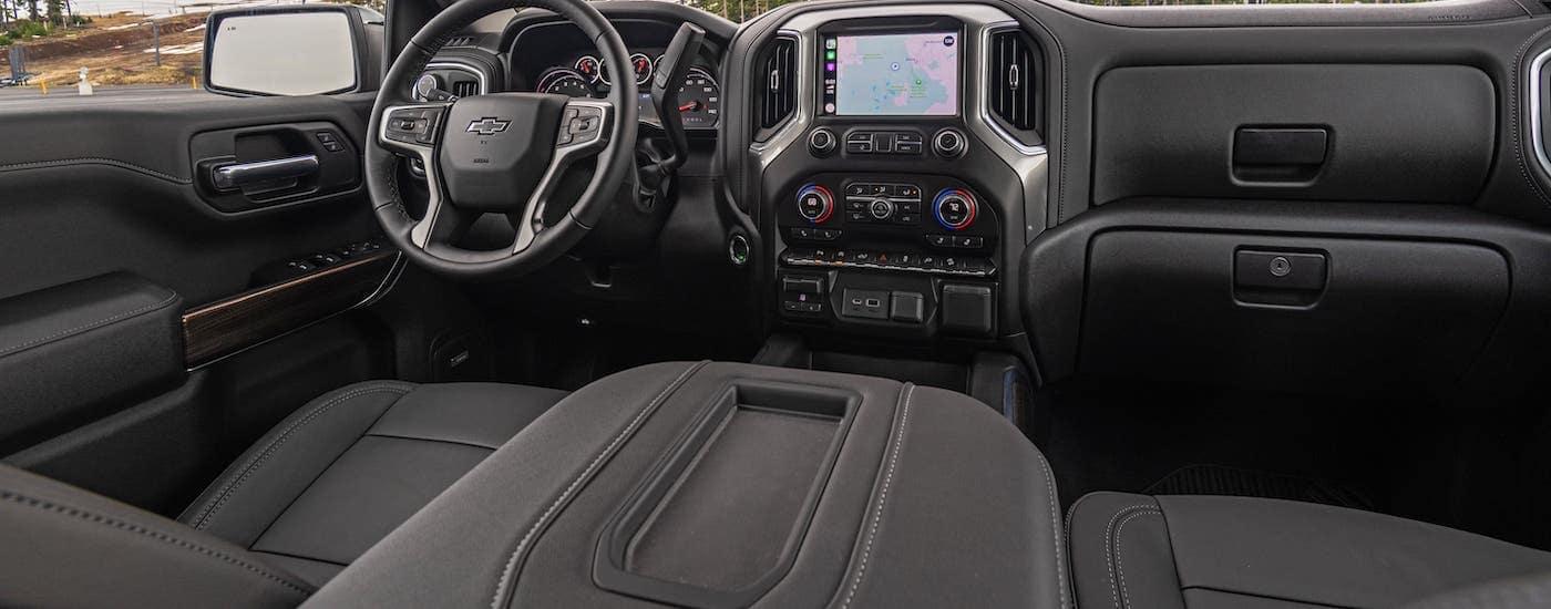The black interior of a 2020 Chevy Silverado 1500 is shown.