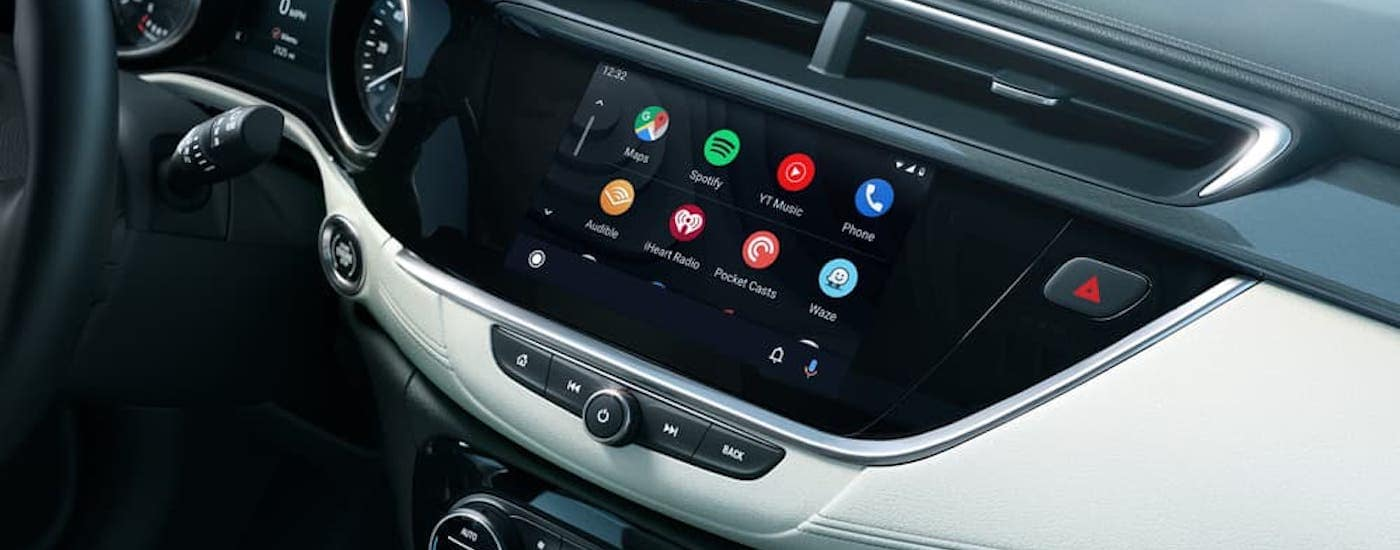 A closeup shows the available apps on the infotainment screen in a 2020 Buick Encore GX.