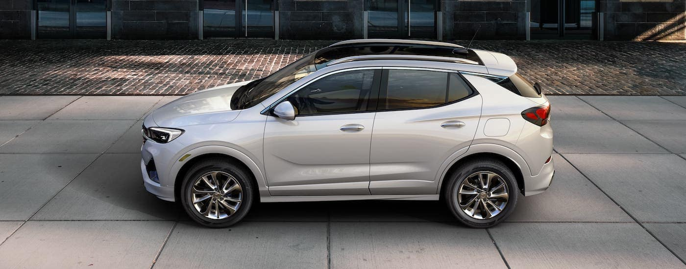 A silver 2020 Buick Encore GX is shown from the side at a high angle while parked on a street near Lexington, KY.