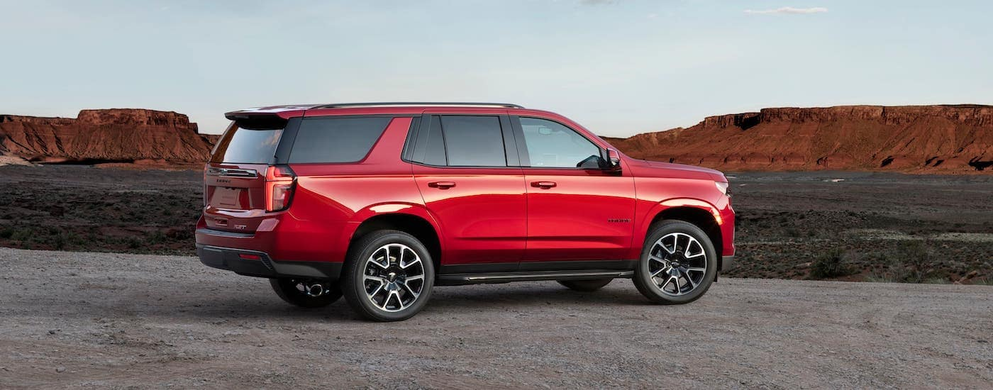 A red 2021 Chevy Tahoe RST is overlooking a canyon.
