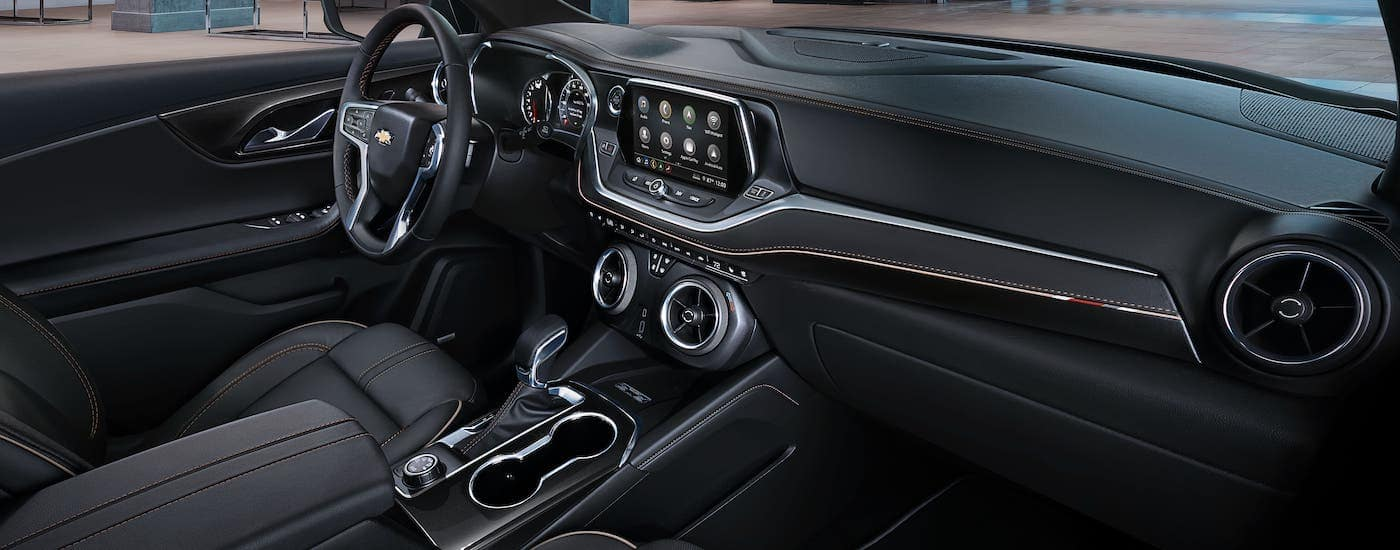 The black interior of a 2020 Chevy Blazer is shown from the passenger seat.