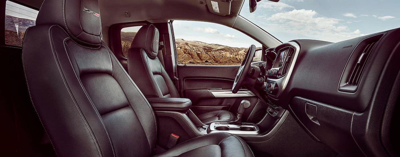 The leather front seats of a 2021 Chevy Colorado ZR2 are shown from the passenger side.
