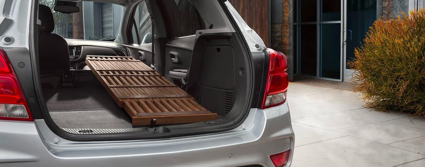 A table is shown in the cargo area of a silver 2021 Chevy Trax.