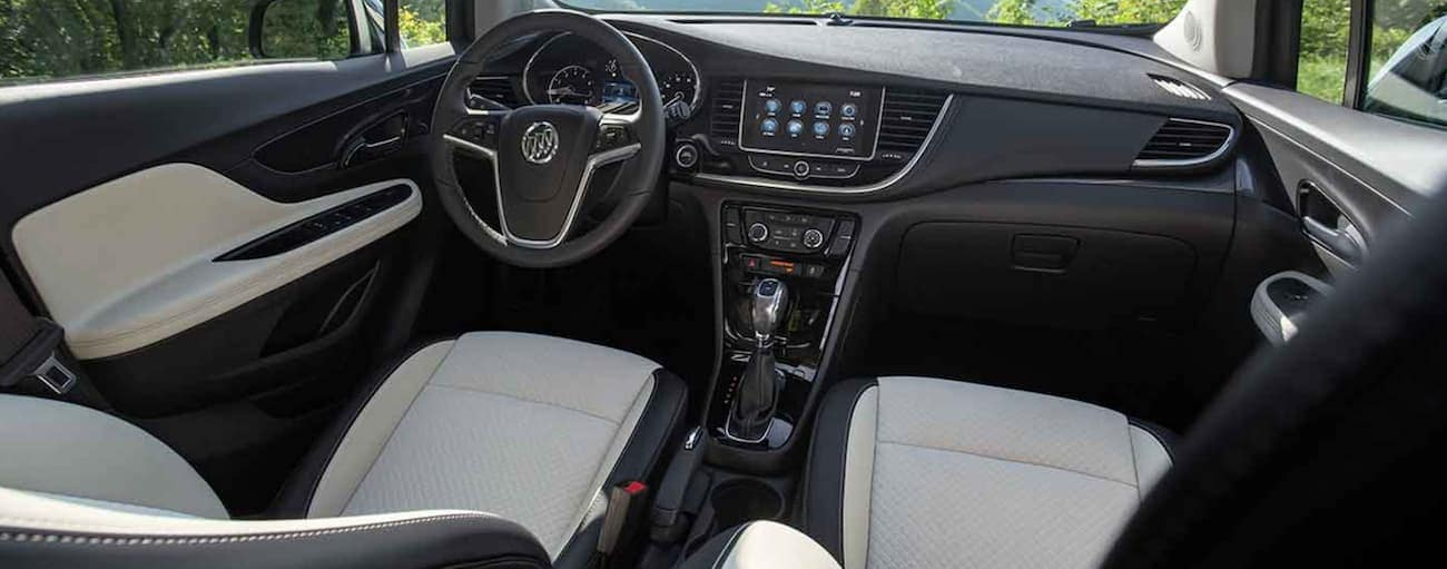 The black and white interior of a 2021 Buick Encore is shown.