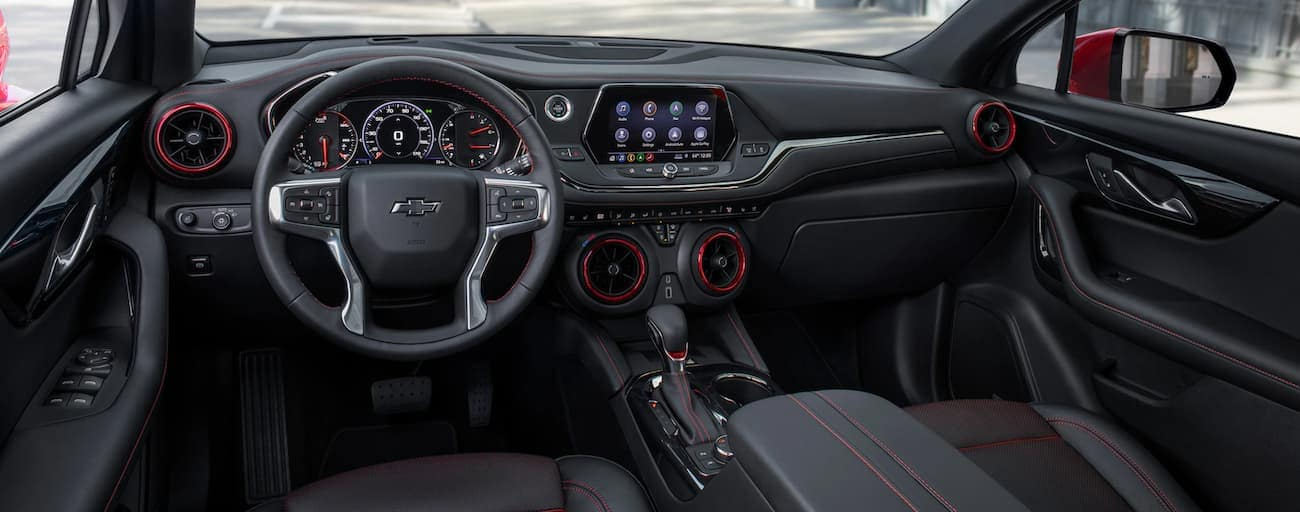 The black interior with red accents is shown in a 2021 Chevy Blazer.