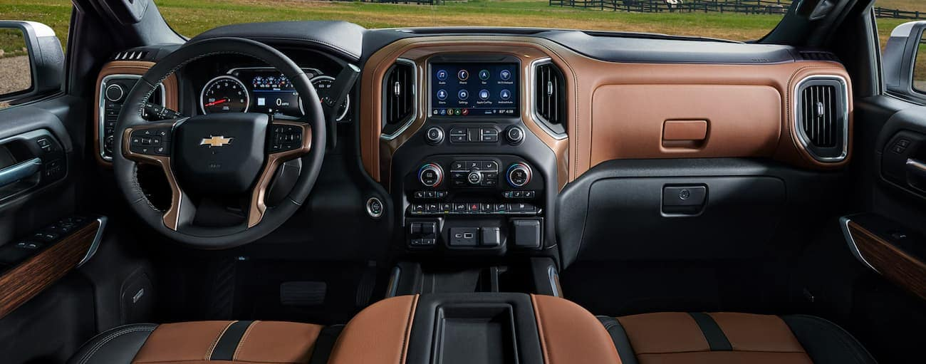 The brown and black interior of a 2021 Chevy Silverado 1500 is shown.