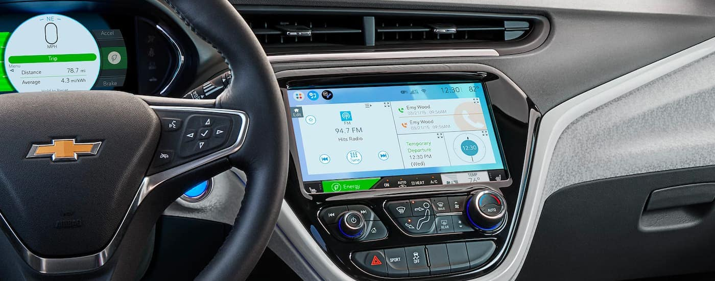 A close up is shown of the gauge cluster and infotainment screen on a 2021 Chevy Bolt EV.