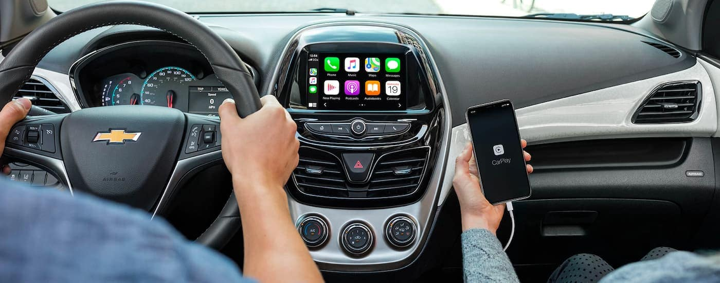 A close up is shown of the infotainment system and apps on a 2021 Chevy Spark.