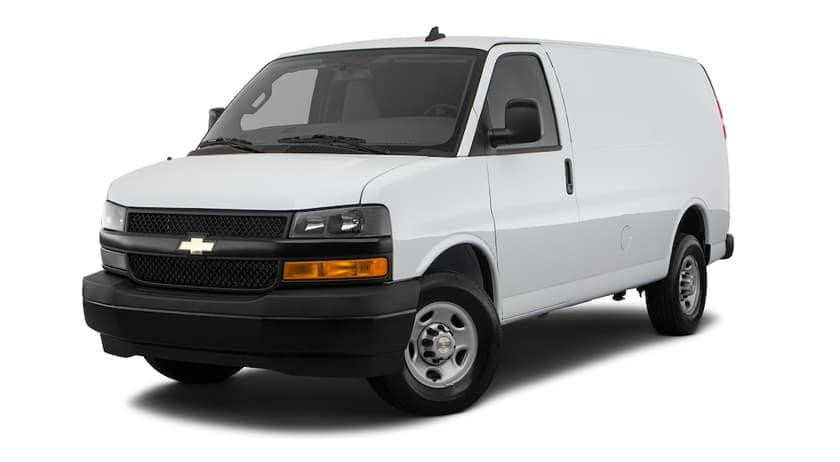 A white 2021 Chevy Express Van in the cargo configuration is facing left.