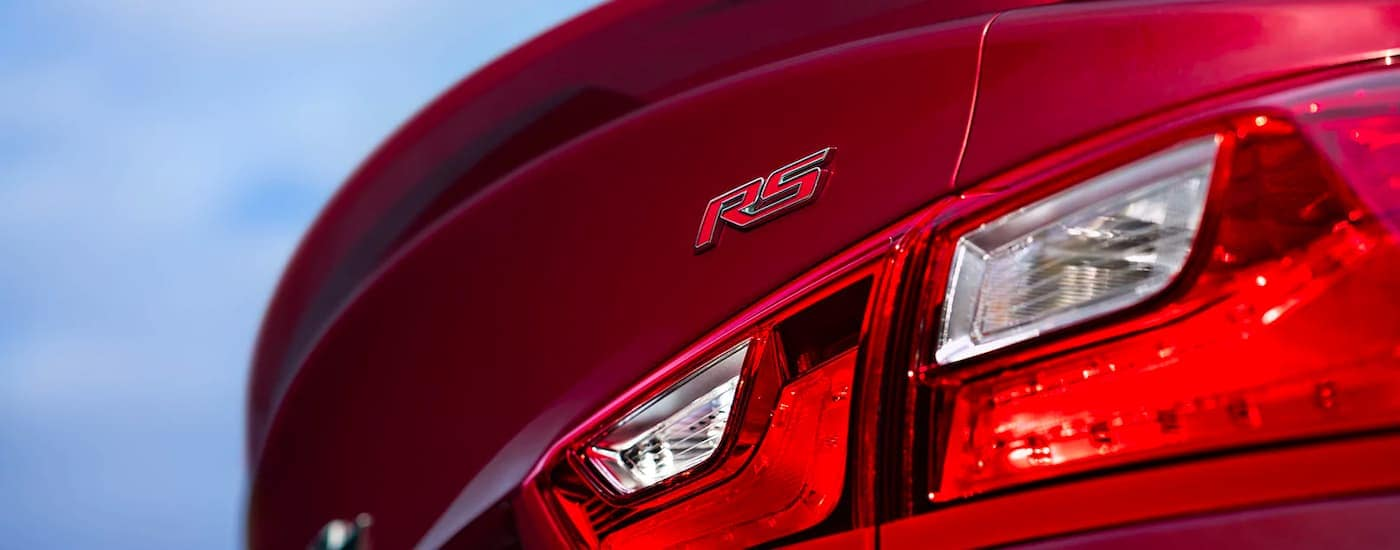 A close up shows the tail light and RS badge on a 2021 Chevy Malibu RS.