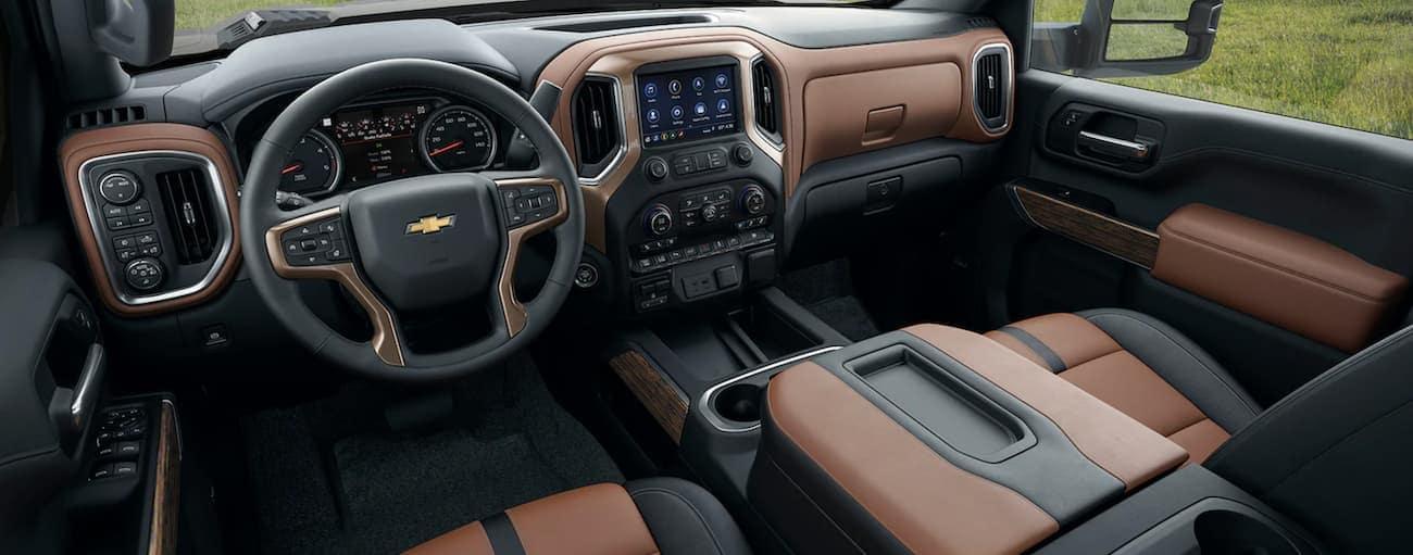 The black and brown interior of a 2021 Chevy Silverado 3500HD.