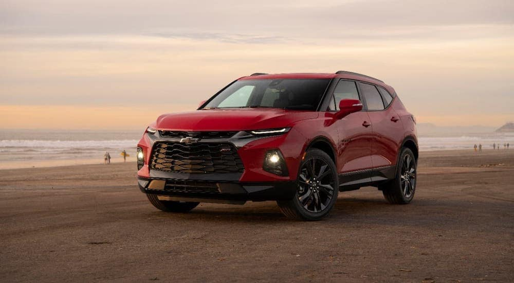A red 2019 Chevy Blazer is parked on a beach.