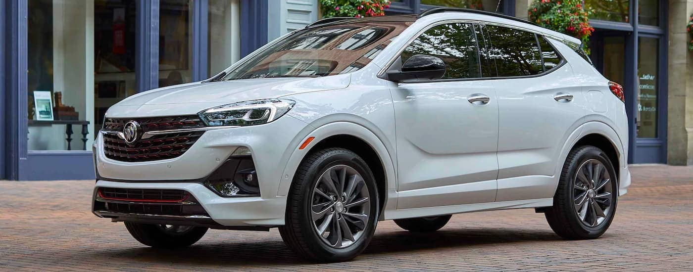 A white 2021 Buick Encore GX is shown from the side after winning the 2021 Buick Encore GX vs 2021 Hyundai Kona comparison.
