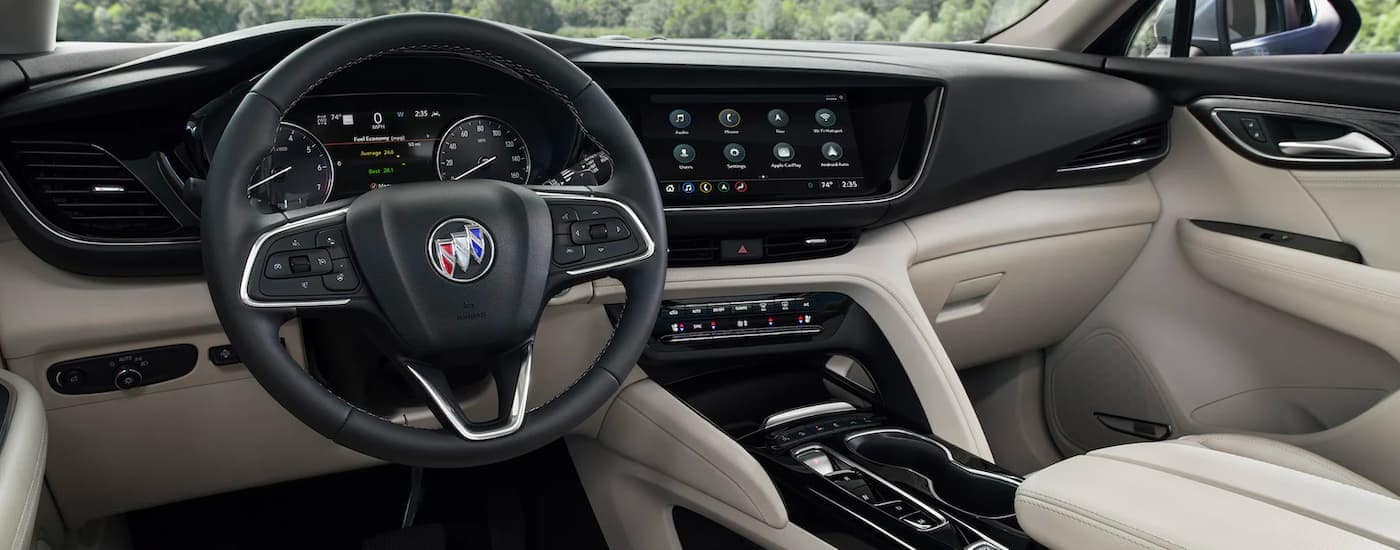The interior and infotainment screen is shown in a 2021 Buick Envision.