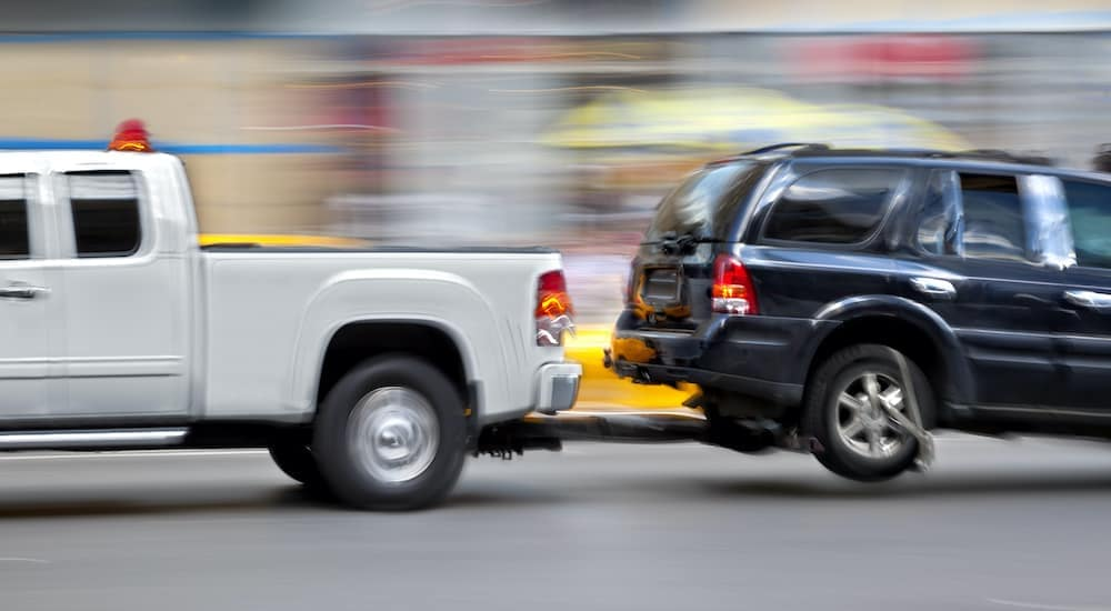 A truck is being used to offer a towing service.