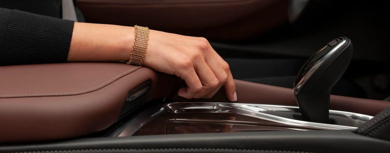 A close up shows the armrest and shifter in a 2021 Buick Enclave Avenir.