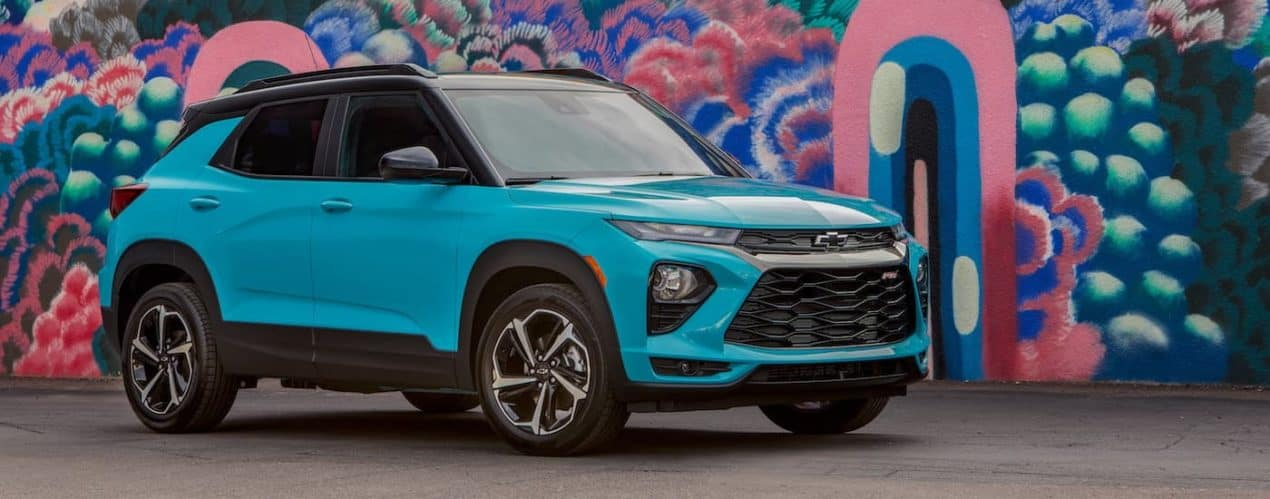 A teal 2021 Chevy Trailblazer RS is shown from the side parked in front of a mural.