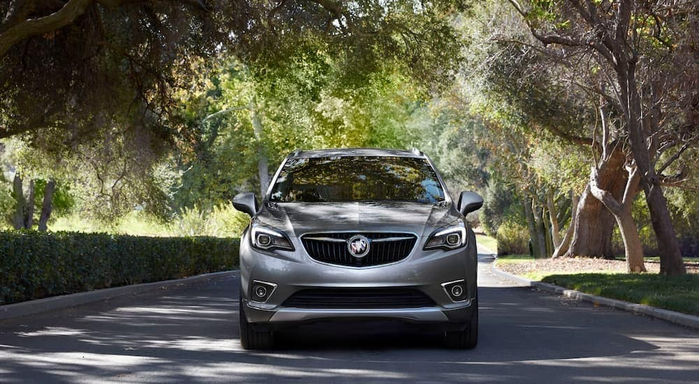 A grey 2020 Buick Envision is shown from the front after leaving a Kentucky used car dealership.