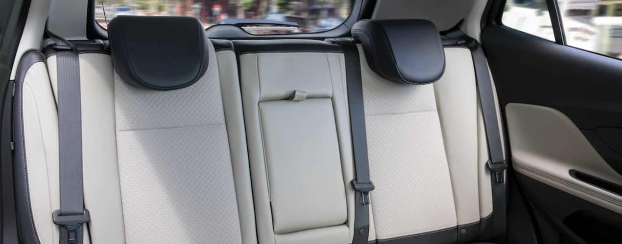 The black and white interior of a 2022 Buick Encore shows the back seats.