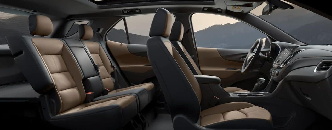 The interior of a 2022 Chevy Equinox shows two rows of seating and the steering wheel.