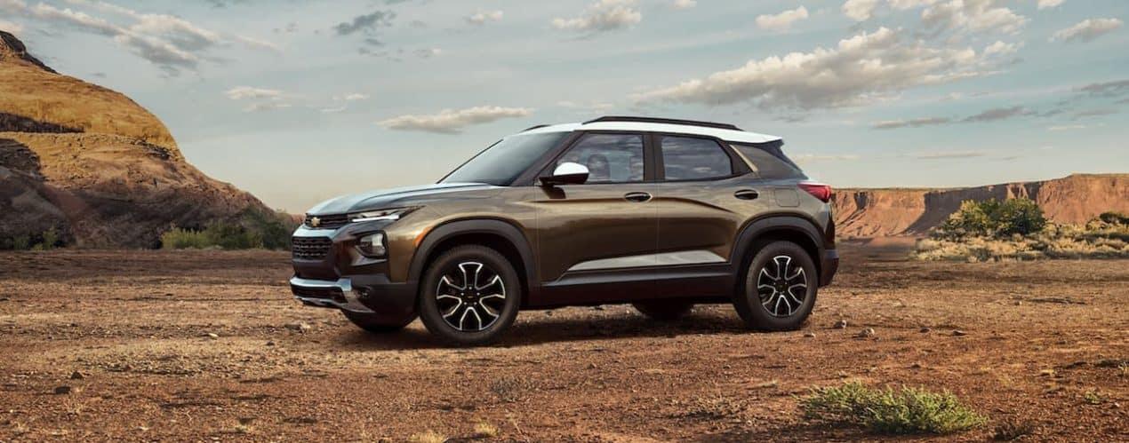 A bronze 2022 Chevy Trailblazer is shown parked in a desert.