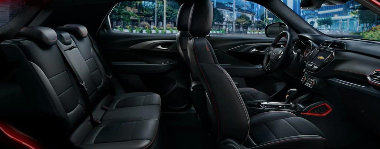 The black interior of a 2022 Chevy Trailblazer shows two rows of seating.