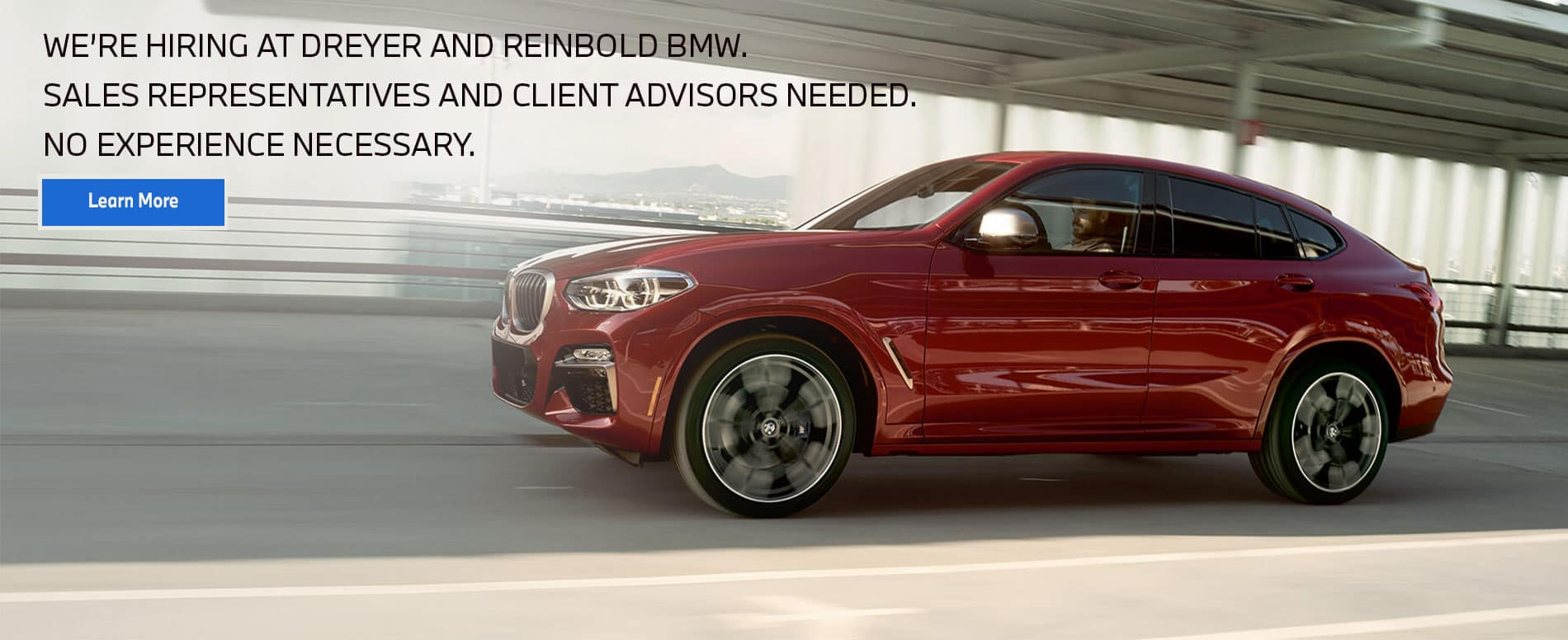 We are hiring! Click to Learn More. Image of red vehicle driving on road.