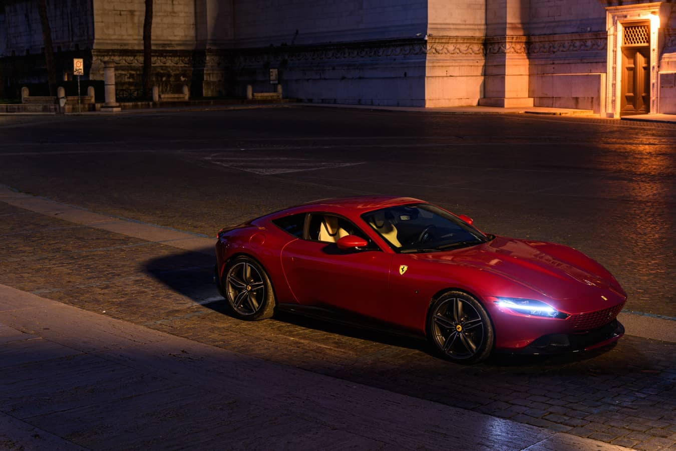 Ferrari Roma parked outside at night