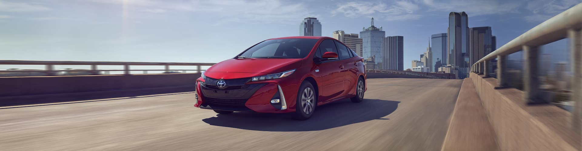 Halterman's Toyota is a Toyota Dealership near Saylorsburg, PA | 2021 Toyota Prius Prime driving away from city