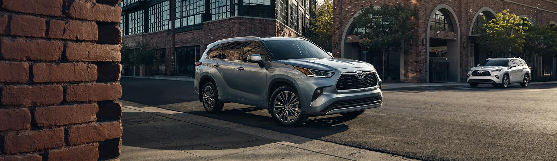 Halterman's Toyota is a Toyota Dealership near Scranton, PA | 2021 Toyota Highlander driving on city street