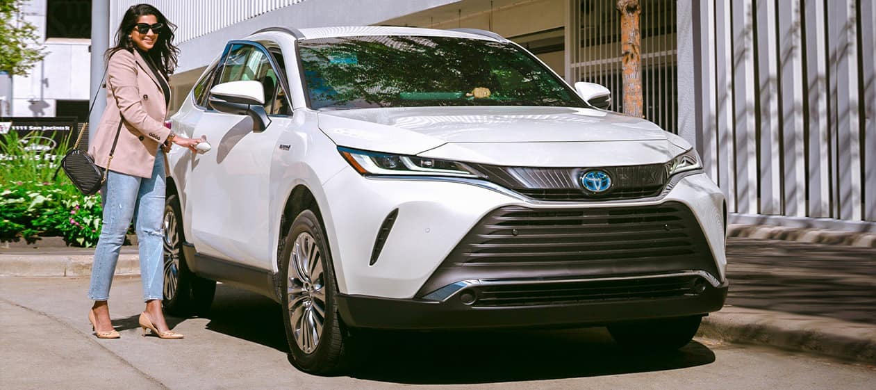 Halterman's Toyota is a Toyota Dealership near Saylorsburg, PA | Stylish woman entering 2021 Toyota Venza
