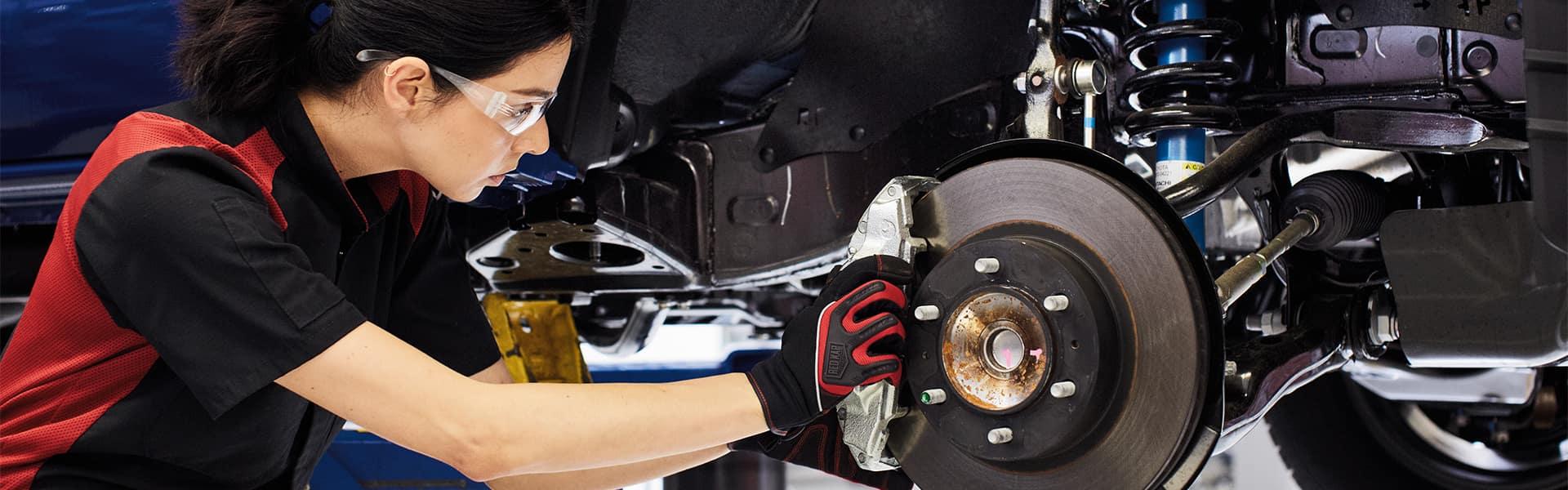 Halterman's Toyota is a Toyota Dealership near Cresco, PA   Service Advisor Fixing Brakes on Vehicle