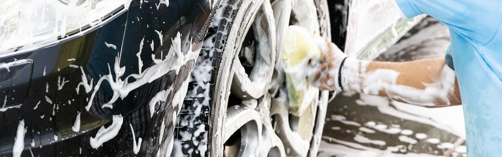 Tips for spring cleaning your car at Halterman's Toyota in East Stroudsburg   Man Washing Exterior of Vehicle