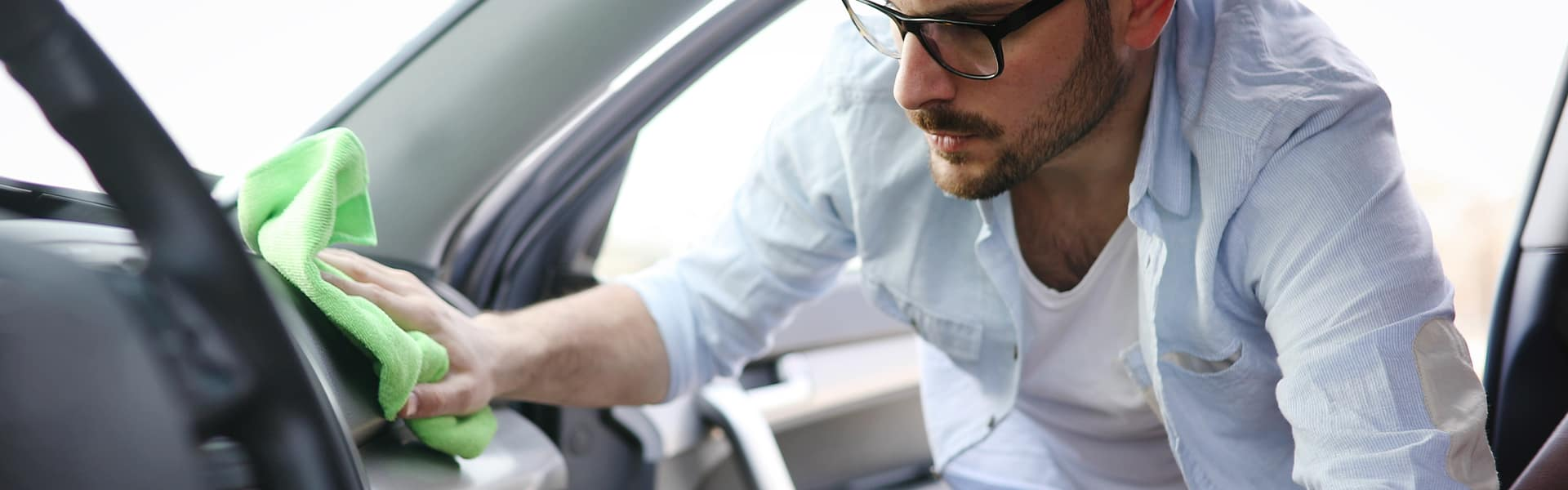 Tips for spring cleaning your car at Halterman's Toyota in East Stroudsburg   Man Washing Interior of Vehicle