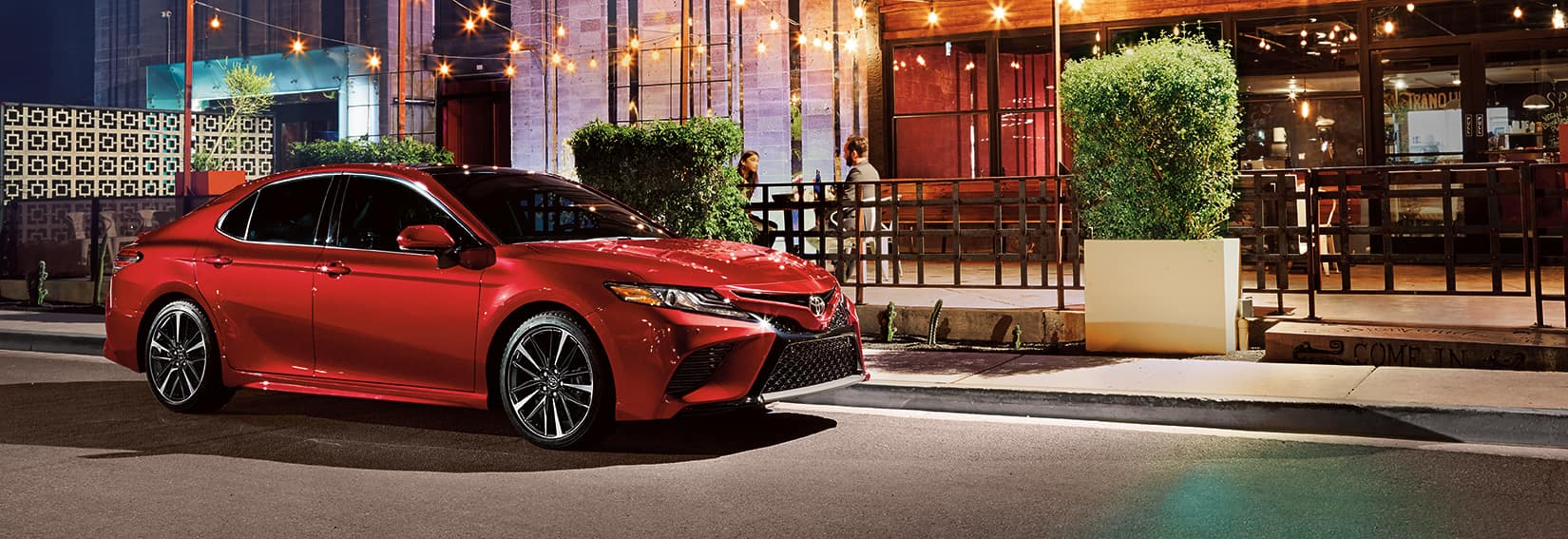 Halterman's Toyota is a Toyota Dealership near Tannersville, PA   2020 Toyota Camry parked in from of restaurant at night