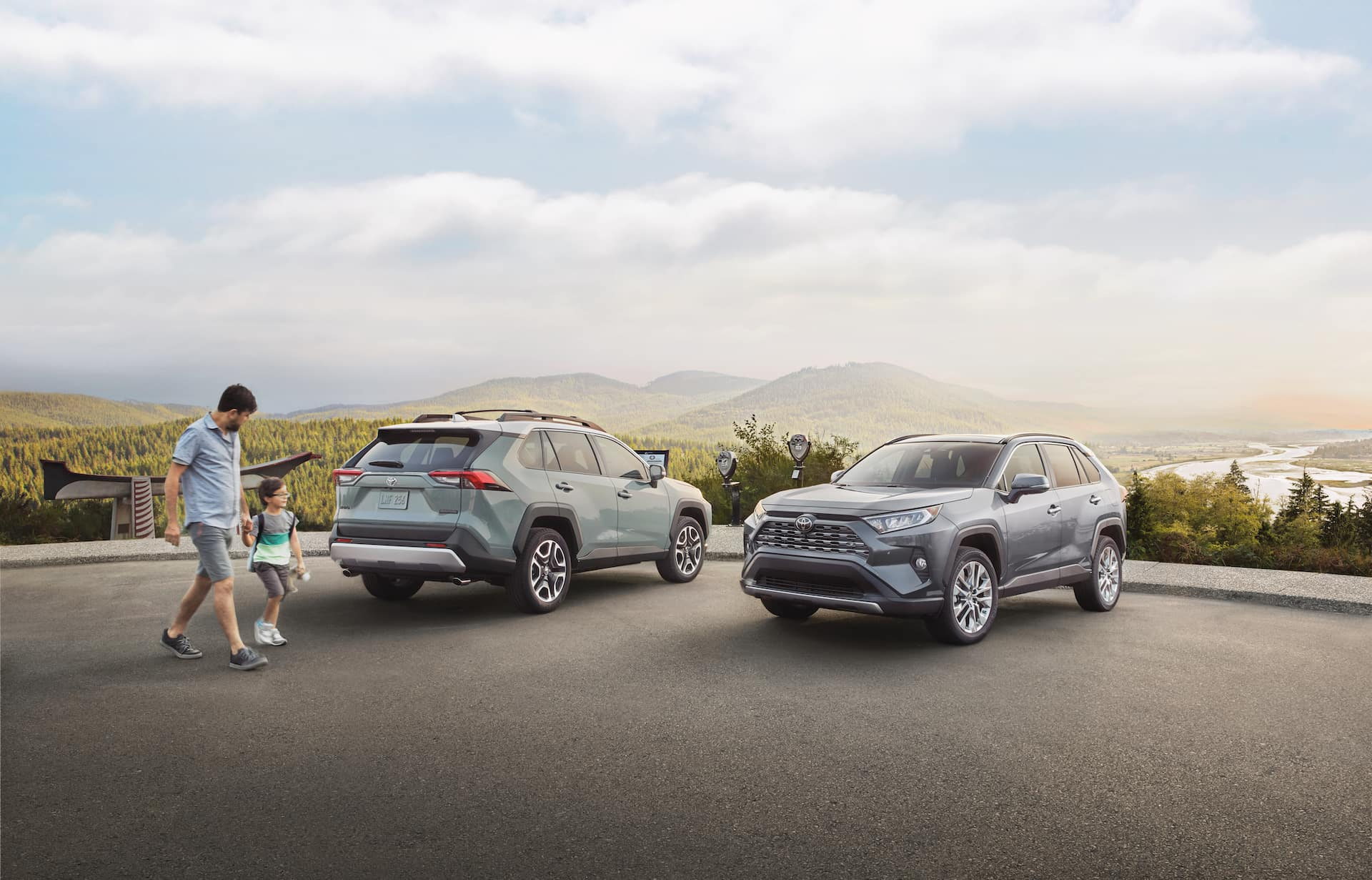 Halterman's Toyota is a Toyota Dealership near Neola, PA | Father and son walking by two 2020 Toyota RAV 4 vehicles parked at scenic overlook