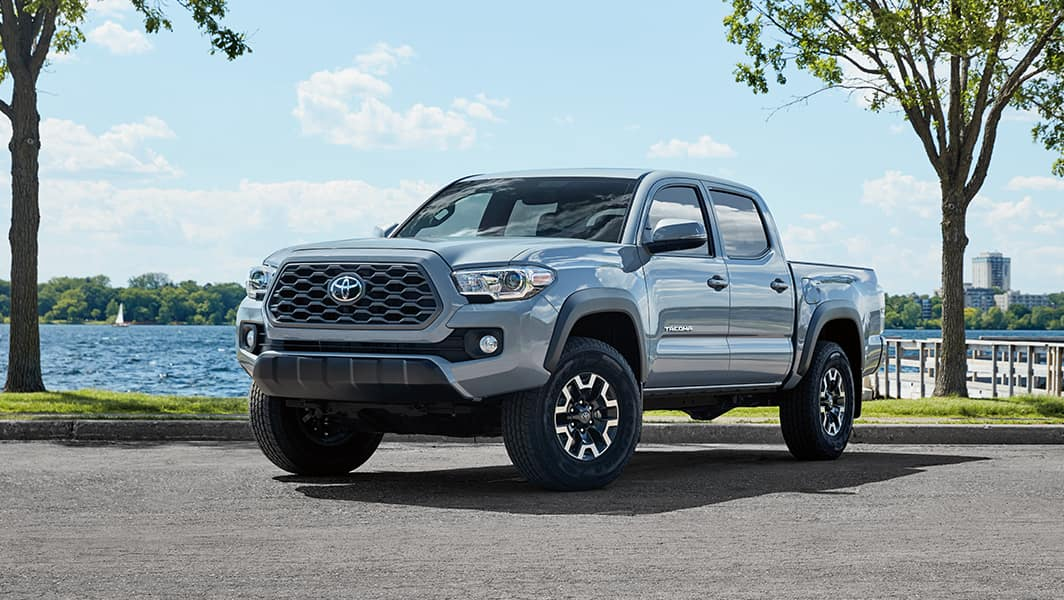 Halterman's Toyota is a Toyota Dealership near Cresco, PA   Blue Tacoma Parked In Front of the Water