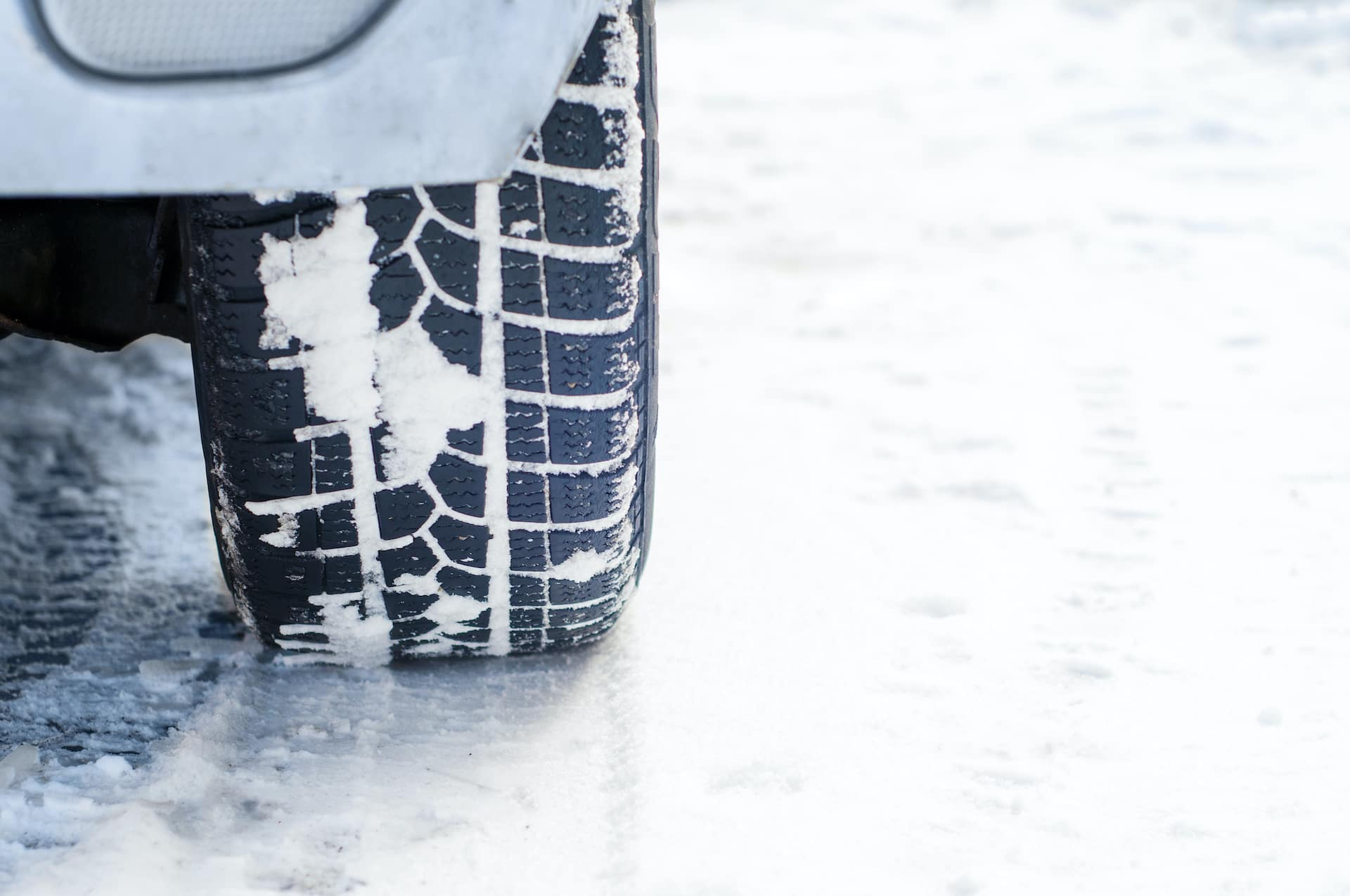 How to prepare your Toyota for the winter season at Halterman's Toyota in East Stroudsburg, PA | Closeup of vehicle tire in the snow