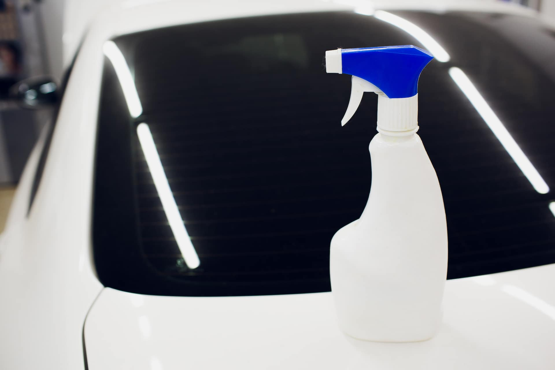 How to prepare your Toyota for the winter season at Halterman's Toyota in East Stroudsburg, PA | Bottle of wiper fluid sitting on car