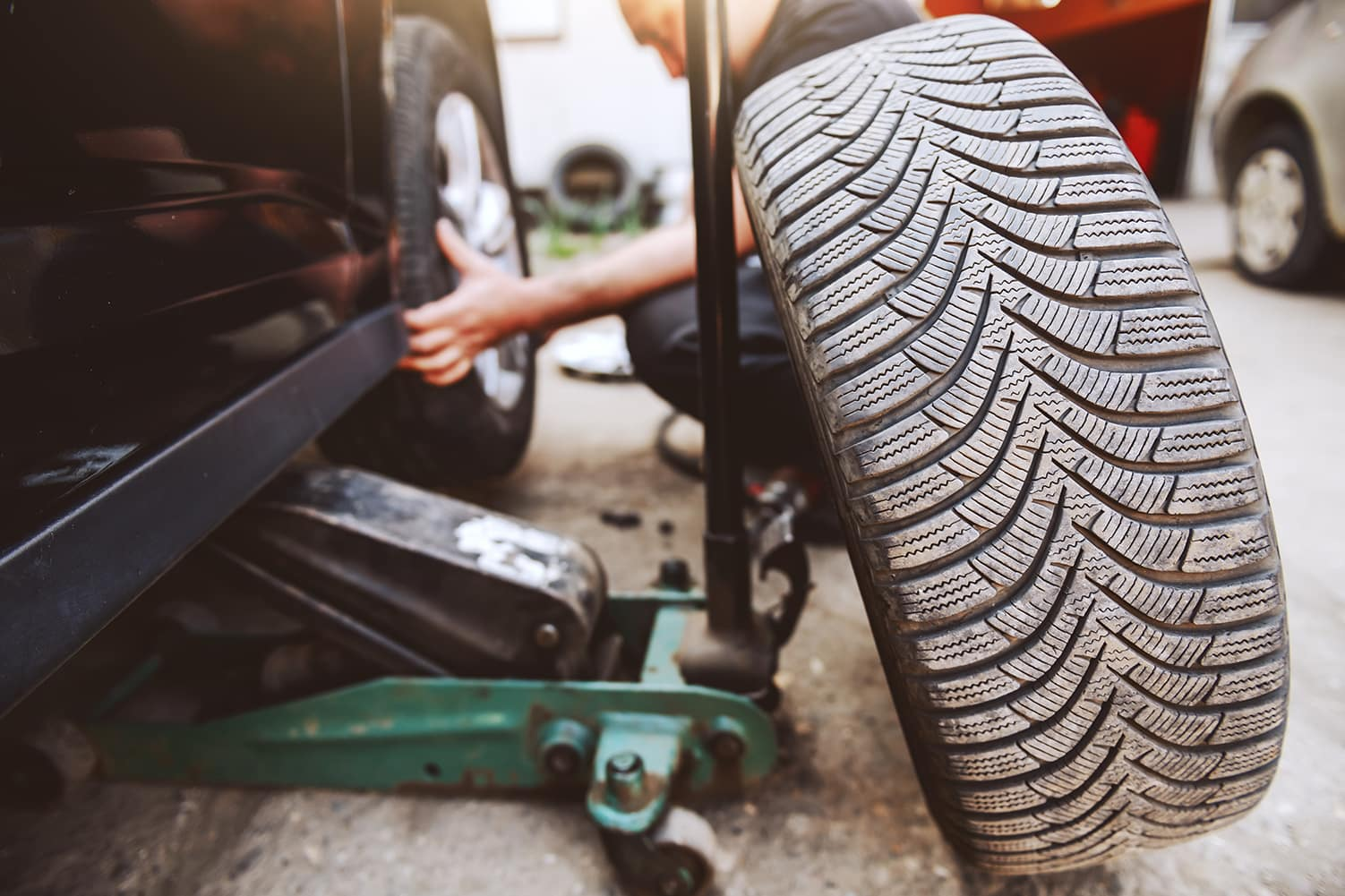 A step-by-step guide to changing a tire by Halterman's Toyota in East Stroudsburg | Man changing flat tire on side of road