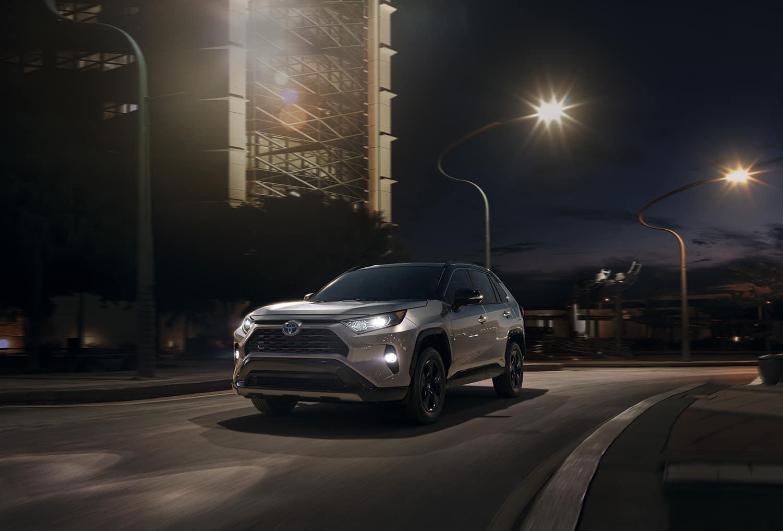 Halterman's Toyota is a Toyota Dealership near Scranton, PA | 2021 Toyota RAV4 driving on city street at night