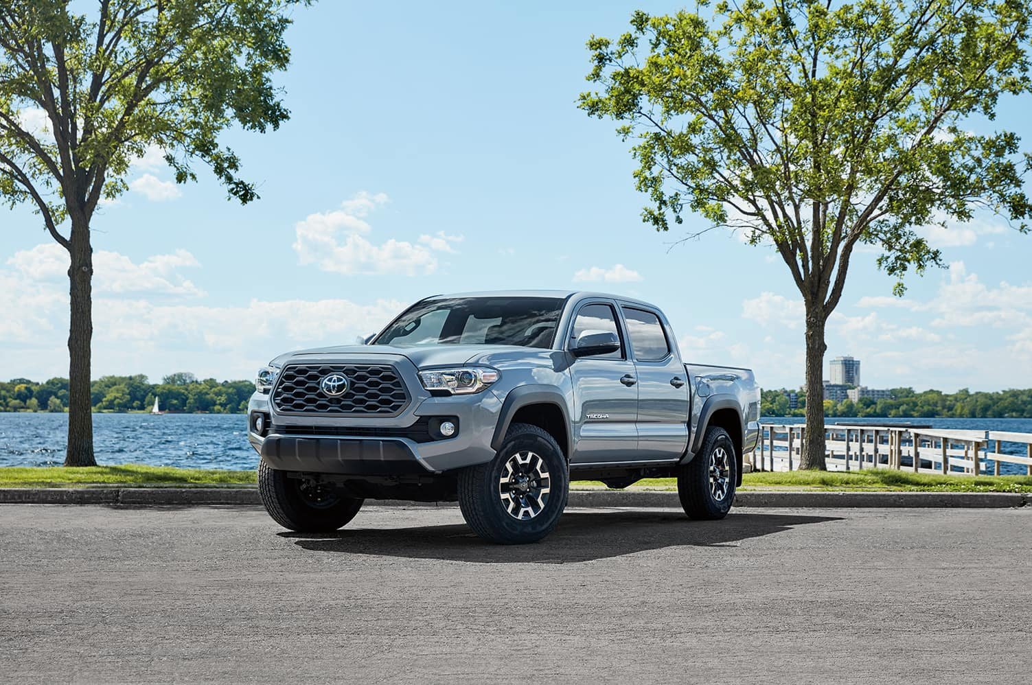 Halterman's Toyota is a Toyota Dealership in East Stroudsburg PA | 2020 Toyota Tacoma parked in front of the lake