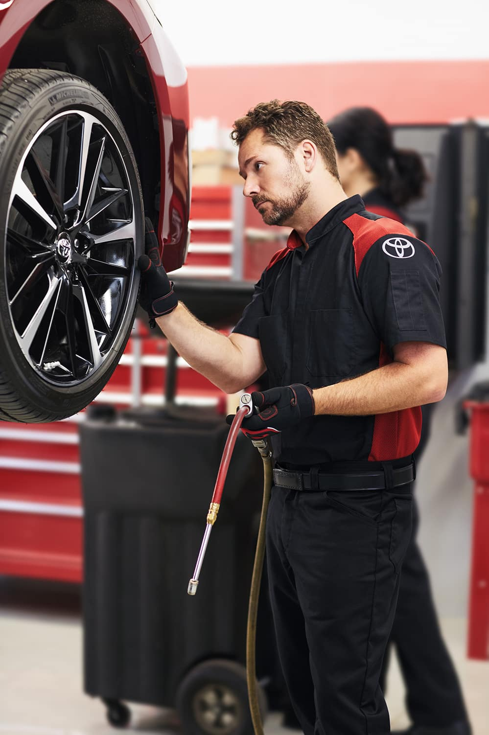 Halterman's Toyota is a Toyota Dealership in East Stroudsburg PA | Mechanic replacing tires on a Toyota vehicle