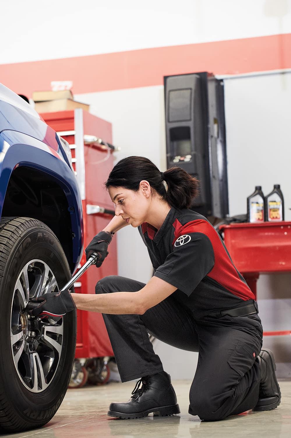 Halterman's Toyota is a Toyota Dealership near Scranton, PA | Toyota mechanic changing tire on a Toyota vehicle