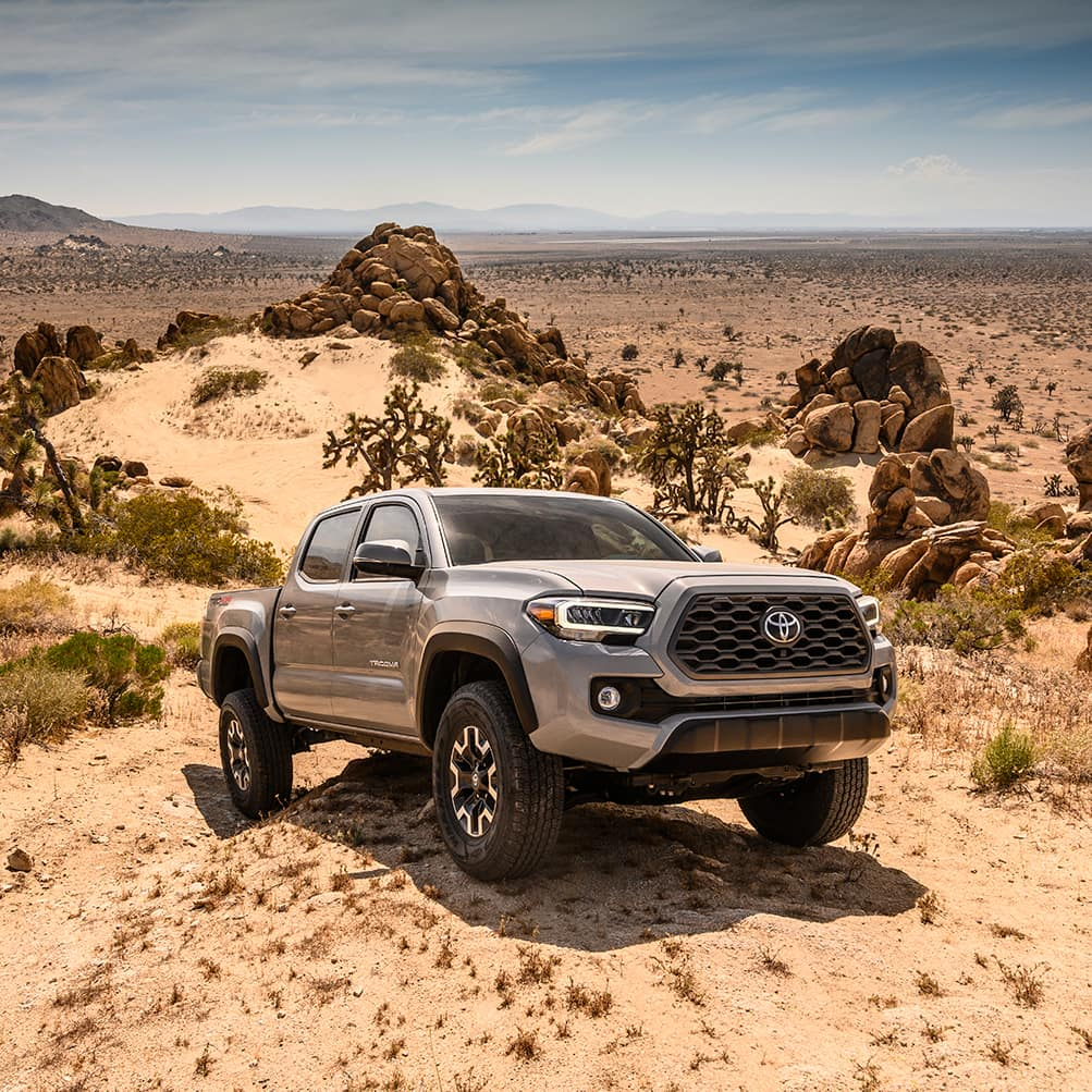 Halterman's Toyota is a Toyota Dealership near Delaware Water Gap, PA   2020 Toyota Tacoma parked in the sand