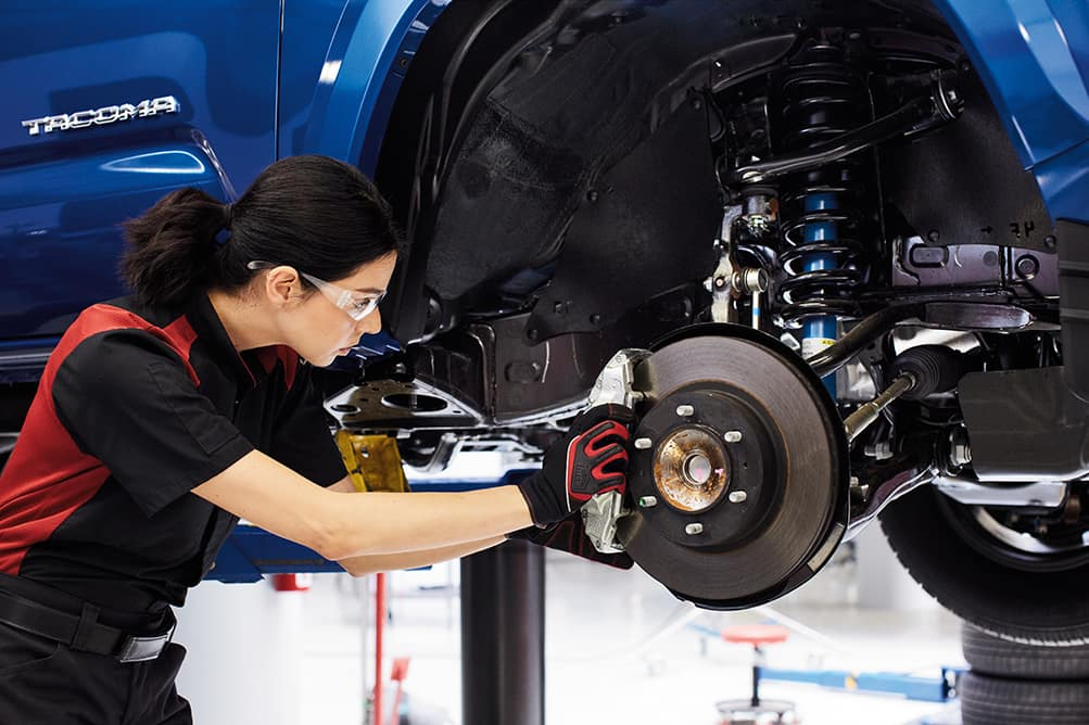 3 Main Benefits of Using OEM parts for your vehicle at Halterman's Toyota of East Stroudsburg | Toyota Service Technician replacing brakes on Toyota vehicle