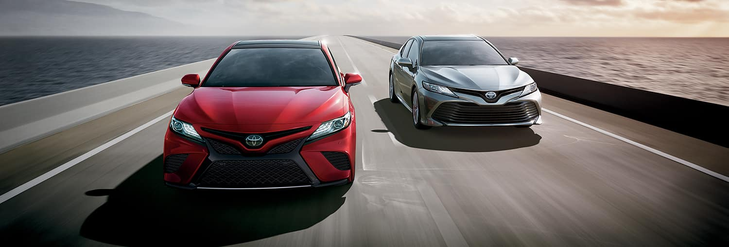 Halterman's Toyota is a Toyota Dealership near Delaware Water Gap, PA   Two 2019 Toyota Camrys driving on a bridge