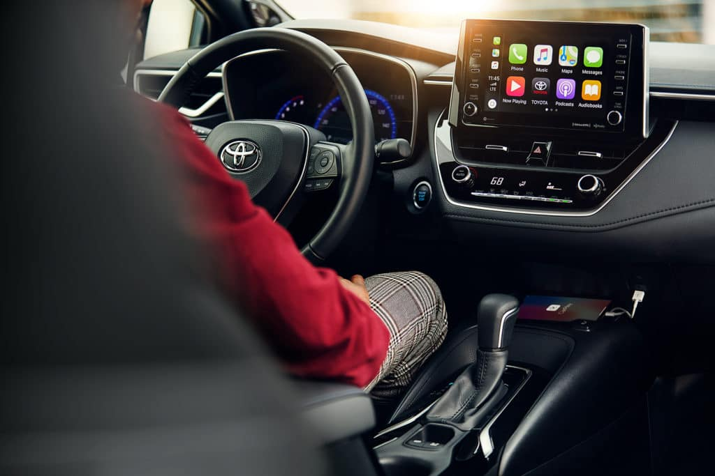 Halterman's Toyota is a Toyota Dealership near Hackettstown, NJ | Person sitting in driver's seat of 2021 Toyota Corolla