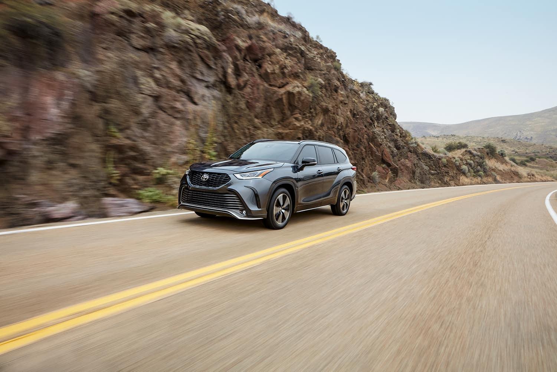 Halterman's Toyota is a Toyota Dealership near Hackettstown, PA | 2021 Toyota Highlander driving on mountain road